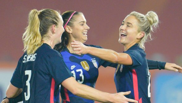 USWNT players Alex Morgan, Sam Mewis, and Kristie Mewis celebrate after a goal