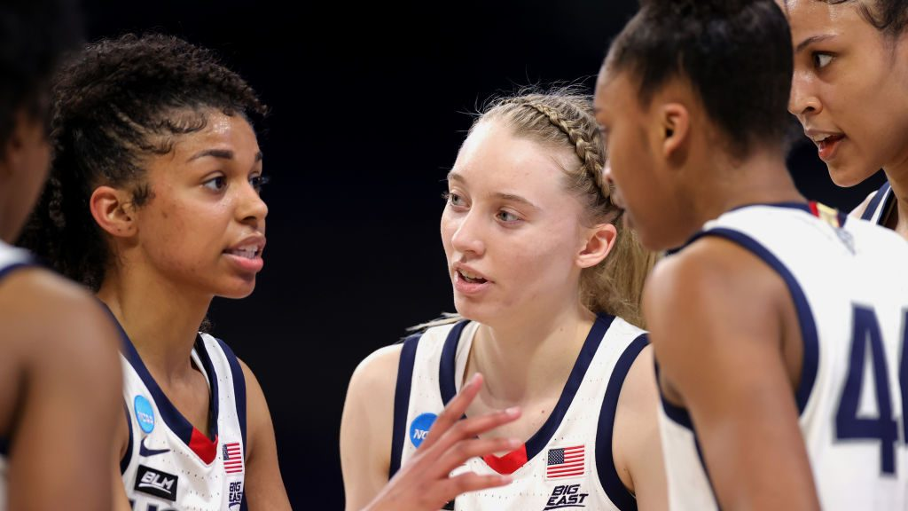 Paige Bueckers #5 of the UConn Huskies huddles with teammates during the second half against the High Point Panthers in the first round game of the 2021 NCAA Women's Basketball Tournament