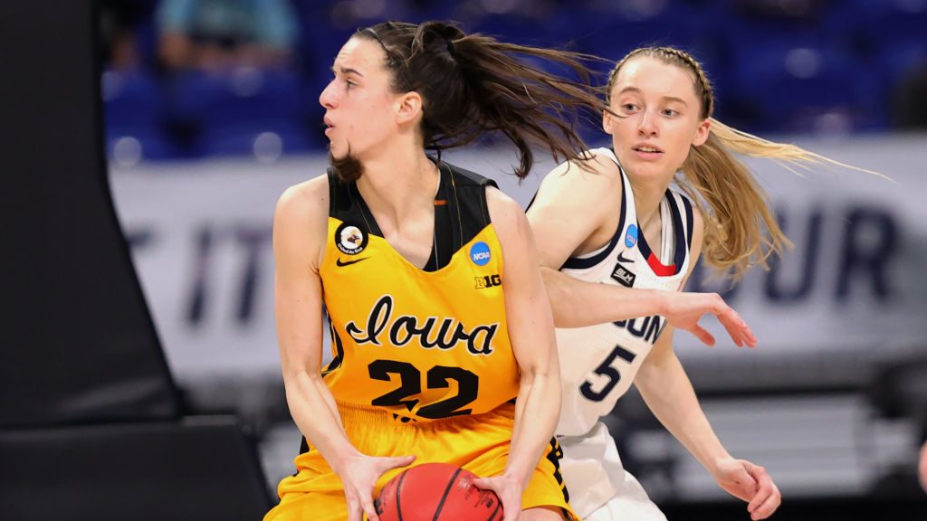Paige Bueckers #5 of the UConn Huskies defends Caitlin Clark #22 of the Iowa Hawkeyes