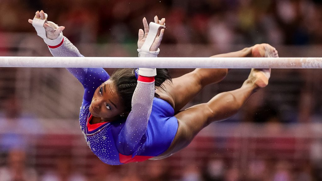 Simone Biles competing on uneven bars at US Olympic Trials