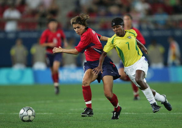 Formiga (Brazil) and Mia Hamm (United States) go head-to-head during the gold medal game at the 2004 Athens Olympics. (Photo by Shaun Botterill/ Getty Images)