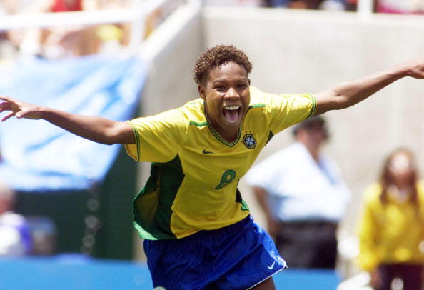 Formiga (Brazil) celebrates her game winning shoot-out goal during the third-place game at the 1999 Women's World Cup. (Photo credit: MIKE FIALA/AFP via Getty Images)
