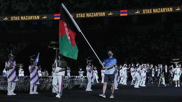 """While neither Khudadadi and Rasouli was able to march in the Opening Ceremony of the Tokyo Paralympics last week, Afghanistan's flag was carried into the stadium as a symbol of were both absent from the Tokyo Paralympics Opening Ceremony on Tuesday night, where the Afghanistan flag was waved as a symbol of """"solidarity and peace."""""""