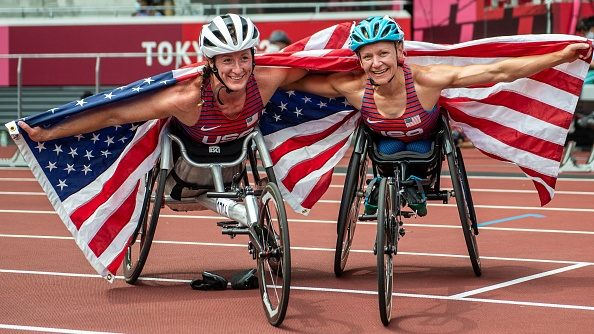 Susannah Scaroni (right) and Tatyana McFadden (left) celebrate after winning gold and bronze in the women's 5000m T54 at the 2021 Tokyo Paralympics