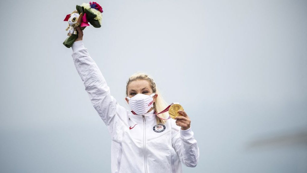Oksana Masters celebrates on the podium after winning gold in the women's H4-5 cycling time trial at the 2021 Tokyo Paralympics