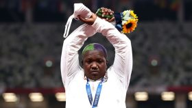 Raven Saunders demonstrates on the Olympic podium by making an 'X' with her arms