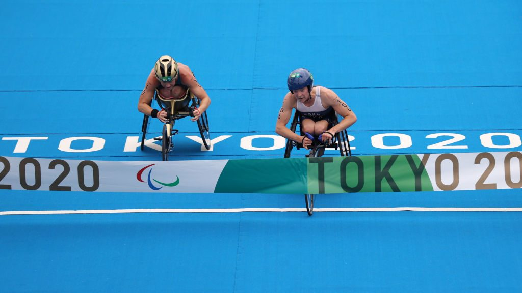 American Kendall Gretsch crosses the finish line just ahead of Australian Lauren Parker to win gold in the Paralympic debut of the women's triathlon PTWC2 at the 2021 Tokyo Paralympics.