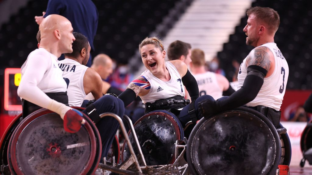 Great Britain's Kylie Grimes celebrates winning wheelchair rugby gold at the 2021 Tokyo Paralympics. Grimes is the first woman to win Paralympic gold in the history of the sport.