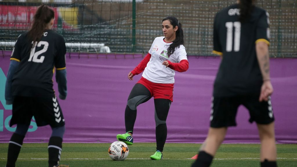 Former Afghanistan women's football captain Khalida Popal (C) attends a training session in south London on March 30, 2018.