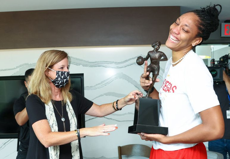 A'ja Wilson of the Las Vegas Aces is presented with the 2020 WNBA MVP award by WNBA Commissioner Cathy Engelbert.