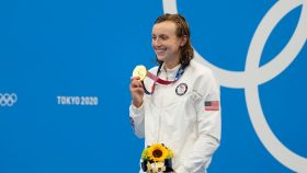 Swimmer Katie Ledecky poses on the medal podium at the Tokyo Olympics