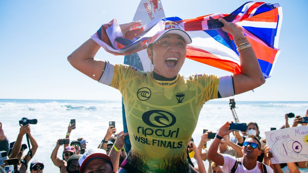 Carissa Moore celebrates after winning the 2021 World Surf League (WSL) Championship Tour (CT) title