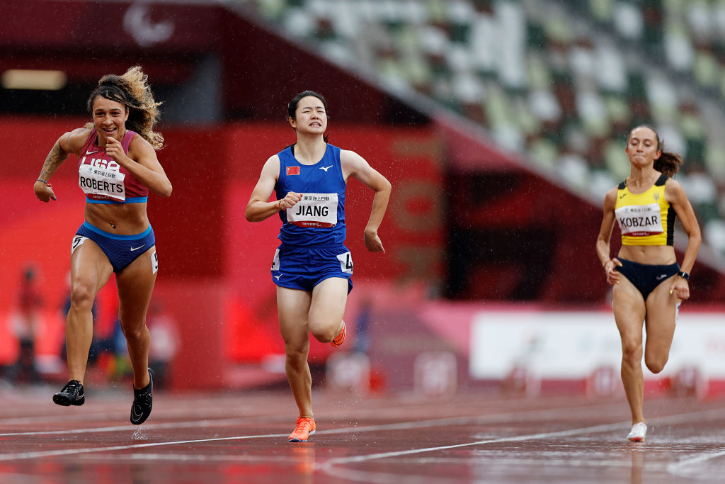 TOKYO, JAPAN - In the women's 100m T37 at the Tokyo Paralympics, Jaleen Roberts (left) of the United States crossed the finish line just 0.01 seconds ahead of China's Jiang Fenfen (center).