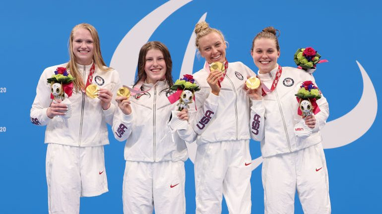 Gold medalists Hannah Aspden, Mikaela Jenkins, Jessica Long and Morgan Stickney of Team United States pose during the women's 4x100m Medley Relay - 34 points medal ceremony on day 9 of the Tokyo 2020 Paralympic Games