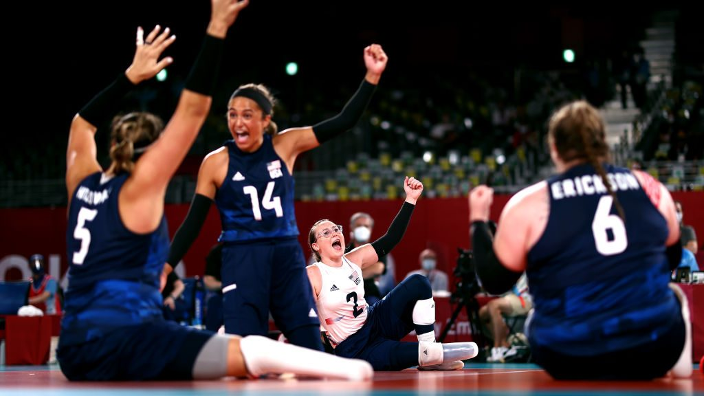 The US women's sitting volleyball team celebrates a point during the gold medal game against China