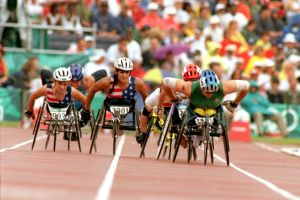 Cheri Madsen (center, then Cheri Becerra) competing in the 800m at the 1996 Atlanta Paralympic Games.