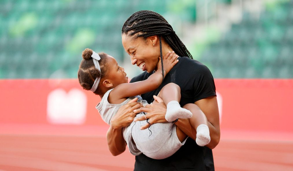 Allyson Felix and her daughter Cammy celebrate on the track at U.S. Olympic Trials in June 2021