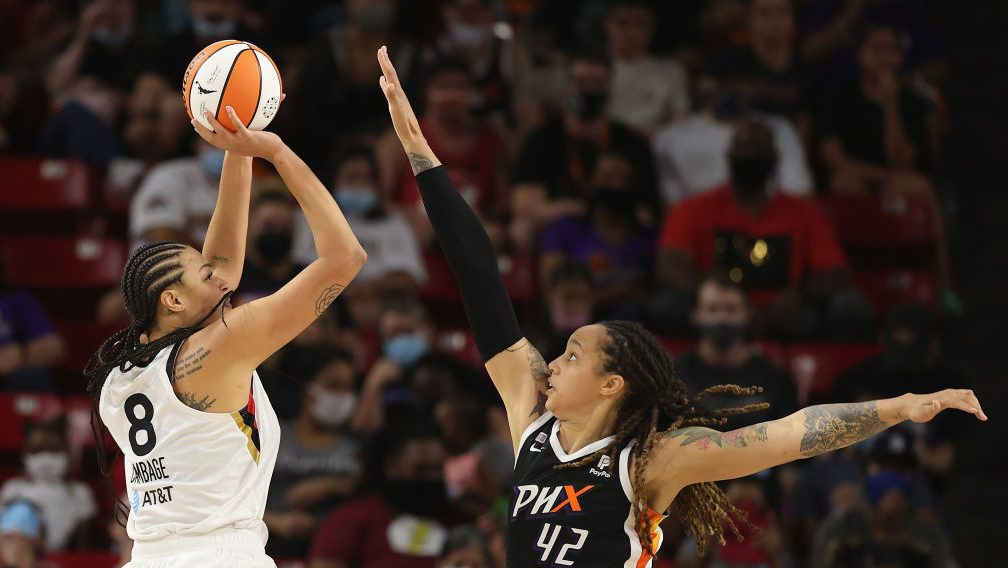 Liz Cambage #8 of the Las Vegas Aces attempts a shot over Brittney Griner #42 of the Phoenix Mercury during the second half of Game Three of the 2021 WNBA semifinals at Desert Financial Arena on October 03, 2021 in Tempe, Arizona. The Mercury defeated the Aces 87-6