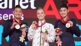 Russia's Angelina Melnikova (center) claimed gold in the women's all-around final at the 2021 World Gymnastics Championships. Leanne Wong (left) and Kayla DiCello (right) claimed silver and bronze, respectively.