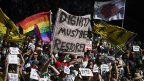Portland Timbers Army fans hold signs showing solidarity with NWSL players before a game against Inter Miami at Providence Park.